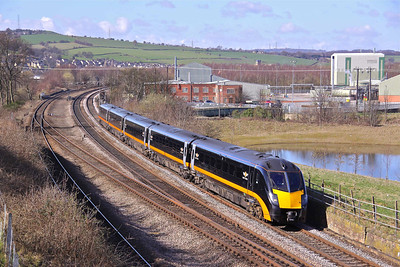 180112 passes Mirfield East with Grand Central's 1A73 10:22 Bradford Interchange - Kings Cross, 18/03/11.