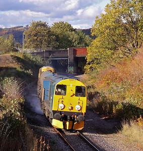 20096 leads 3S14 11:26 Sheffield - Wakefield Kirkgate past a shadowy Neepsend on the Deepcar Branch. 25/10/11.