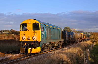 20096 and 20227 are illuminated by the low Autumnal sunshine at 16:38 as they pass Ecclesfield, working 3S14 11:26 Sheffield - Wakefield Kirkgate RHTT. 25/10/11.