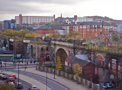 20189 and 20096 pass the site of what used to be Sheffield Victoria Station as they cross the Wicker Arches en route to Deepcar with 3S14 11:26 Sheffield - Wakefield Kirkgate RHTT on 22/11/11.  The Royal Victoria Hotel and its extension which occupies part of the old Station is in the background. Just above the lead loco, poking through the vegatation can be seen an overhead mast still standing 30 years after the Woodhead closed !!   The sun is never on for this shot being on the other side of the line, but a record shot was a must!