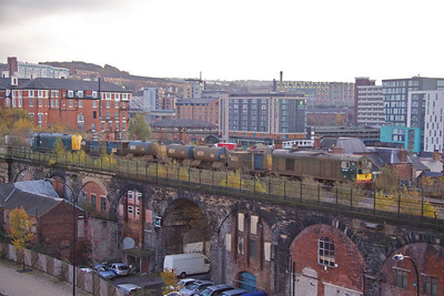 20189 and 20096 ought to be weed spraying rather that rail head jetting as they run over the Wicker Arches, Sheffield, with 3S14 11:26 Sheffield - Wakefield Kirkgate on 22/11/11. A selection of Hotels of different generations form the backdrop with The Royal Victoria being on the left.