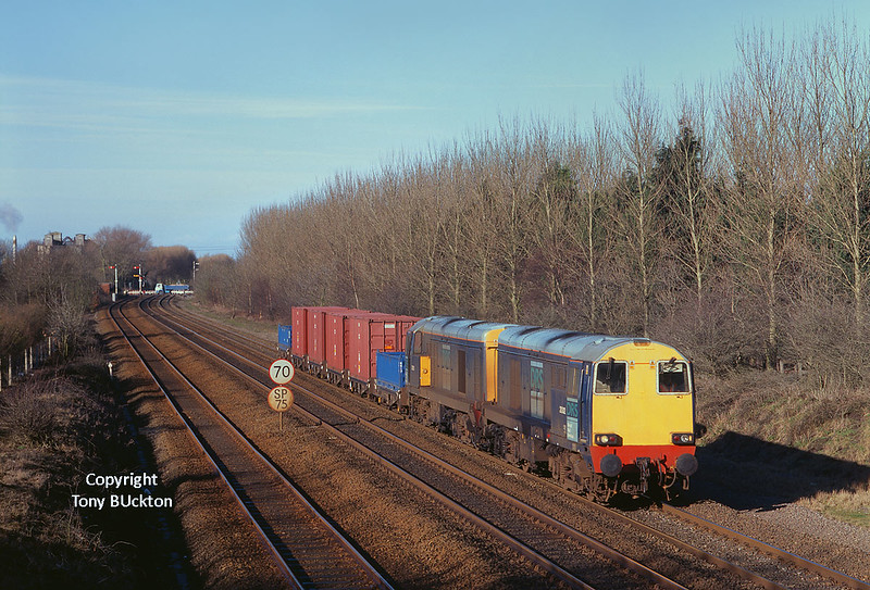 On Monday 18th February 2002, DRS operated a second train of low level radioactive waste for export from Hull King George Dock, the waste having originated from Sellafield (the first train had ran the previous summer). 20302 and 20303 pass Brickyard Lane, Melton,at 10:30 with the 6Z48 05:57 Carlisle - Hull.