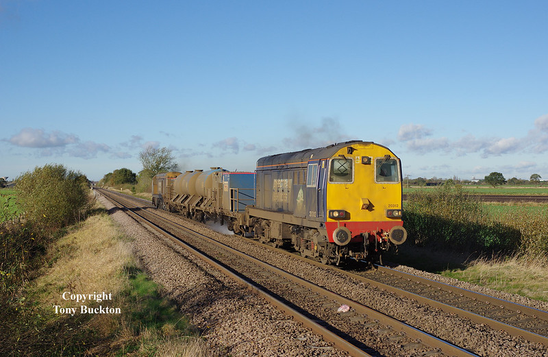 20312 and 20308 pass Maud's Bridge at 09:59 on Monday 3rd November 2014 with the 3S13 08:50 Wrenthorpe Reception - Grimsby Town RHTT.