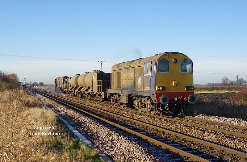 20308 & 309 pass Broomfleet at 12:52 on Saturday 13th  December 2014, with the 11:02 Stocksbridge Works - York Thrall Europa RHTT.