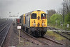 20046 and 20185 take the slow through Barnetby on the afternoon of 14th April 1992 with loaded steel carriers.