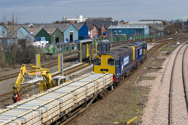Working 'wrong line' 20303 and 20301 enter the work-site at West Parade Jnc, Argyle Street, Hull from the direction of Beverley at 11:38 on Sunday 14th April 2013, with a mixed train of sleepers and ballast from Doncaster. The train was one of three which had worked into Hull the previous evening and had spent most of the morning stood (without motive power) adjacent to Walton Street. Work was being carried out to lower the track level beneath the bridge due to clearance issues - hence the drafting in of DRS 20's to haul traffic through the work-site.