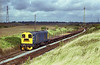 20214 returns to Scunthorpe from Dragonby sidings with empty BDAs at aprox 11:00 on the morning of August 28th 1992