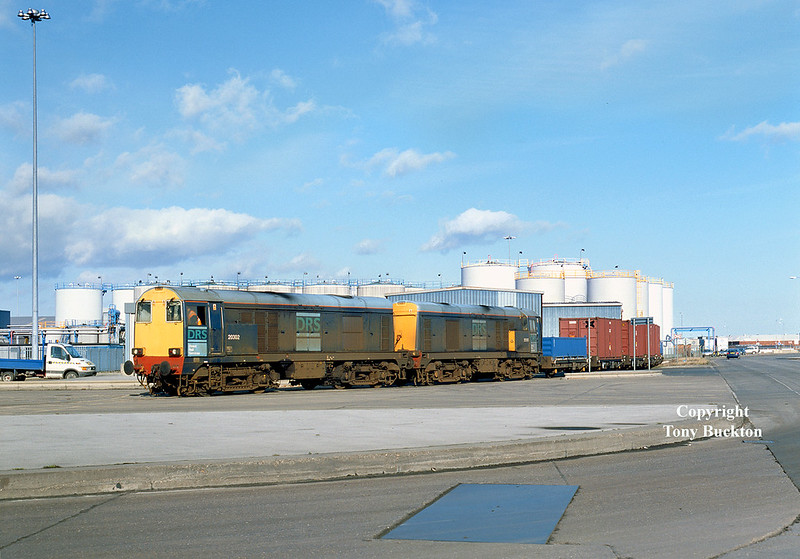 On Monday 18th February 2002, DRS operated a second train of low level radioactive waste for export from Hull King George Dock, the waste having originated from Sellafield (the first train had ran the previous summer). 20302 and 20303 arrive on No 10 Quay, King George Dock at 12:35 with the 6Z48 05:57 Carlisle - Hull.