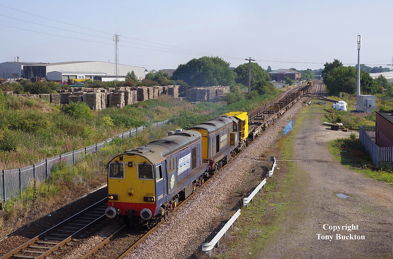 20308 and 20305 pass Kirk Sandall Junction at 10:06 on Sunday 23rd August 2015 with the 6A04 09:15 Ulceby - Doncaster Belmont empty CWR flats.