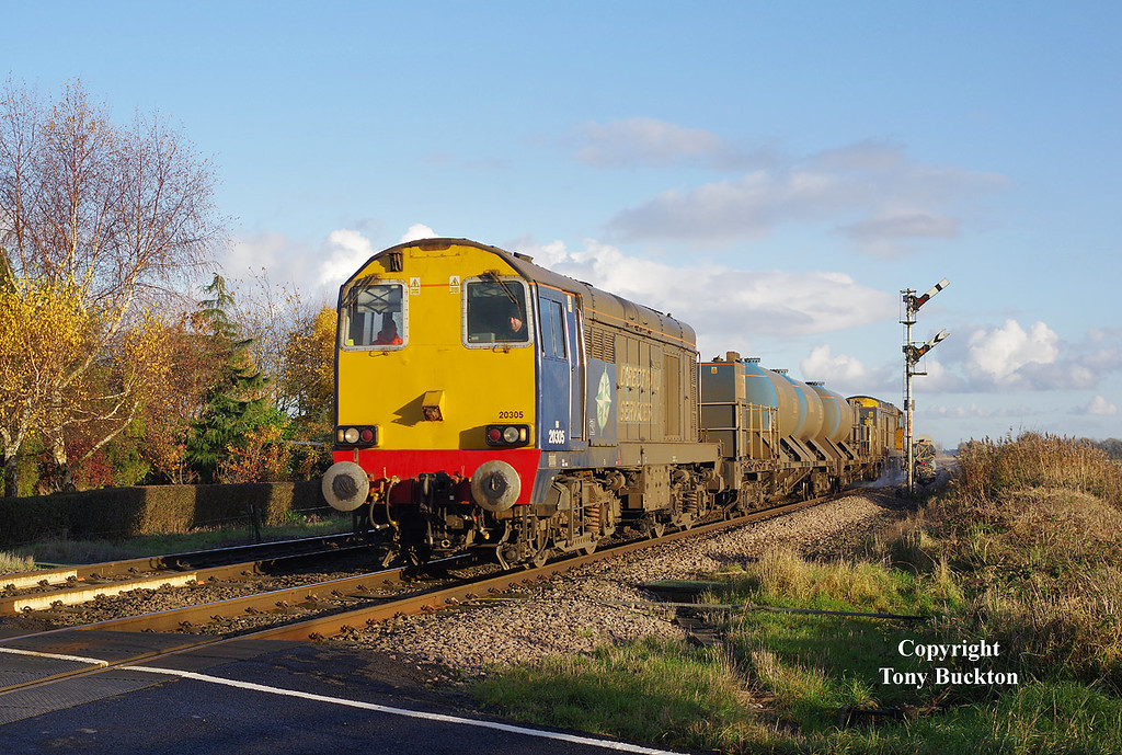 20305 approaches Cave Crossing near Broomfleet with the 11:06 Stockbridge Works - York Thrall Europa railhead treatment train on Saturday 19th November 2016. 20312 brings up the rear.