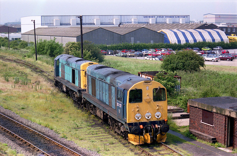 After setting down their train, 20121 and 20190 pause before departure light engine from the sidings at Grimsby - aprox 12:20 on June 10th 1992.