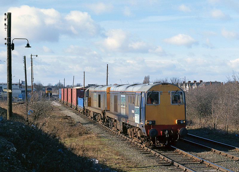 On Monday 18th February 2002, DRS operated a second train of low level radioactive waste for export from Hull King George Dock, the waste having originated from Sellafield (the first train had ran the previous summer). 20302 and 20303 pass the EWS train office at the entrance to King George Dock at 12:30, with the 6Z48 05:57 Carlisle - Hull.