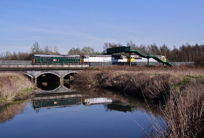 31601 reflects in the River Rother as it heads North on the 'Old Road' at Beighton with 56091 & 56311 in tow, working the 12:00 Washwood Heath - Wolsingham, 27/03/12.
