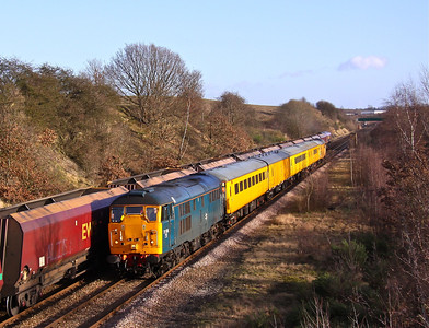 31106 passes the site of the long gone Brookhouse Colliery, between Kiveton and Woodhouse, running about 10 minutes early here, just as 66160 heads in the opposite direction with 4D36 Cottam - Immingham empty coal set. With 31105 on the rear the train was returning from Skegness, working 1Q13 06:39 Derby RTC - Derby RTC, 04/02/13. Though the sky looks 99% blue here, the cloud was rolling in from the West and the light collapsed moments after, so was thankful for the early running !