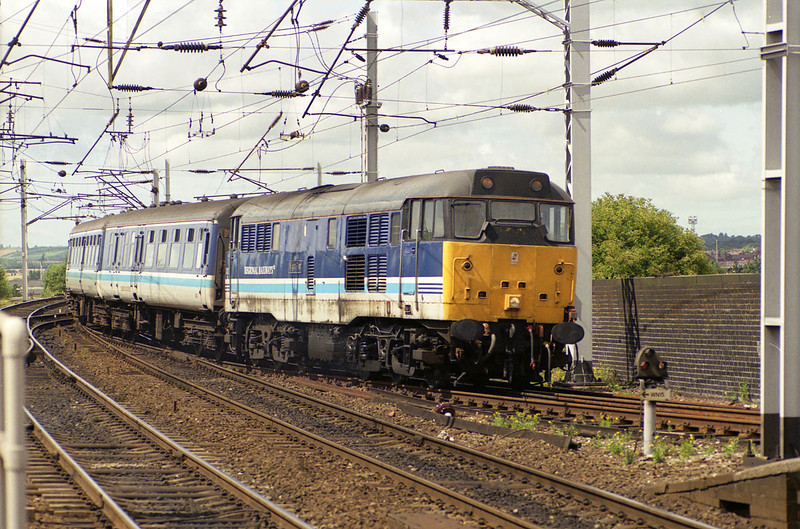 31421 arrives at Wigan North Western with the 13:20 Blackpool North - Liverpool Lime Street on 26th July 1993. I really should NOT write this stuff under the influence - I've been claiming this shot was at the other station in Wigan for the last few weeks!