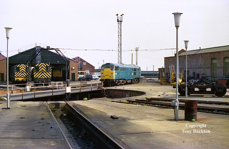 31117 stands near the turntable at Old Oak Common on the afternoon of Saturday 21st April 1984.