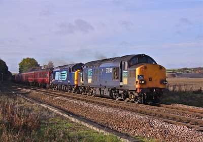 37038 (in original DRS livery) and 37601 'Class 37-Fifty' (in new compass DRS livery) race North past Slitting Mill UWC, North of Barrow Hill, with 'Spitfire Railtours' 1Z37 05:50 Taunton - Saltburn. 47500 was on the rear. 30/10/10.
