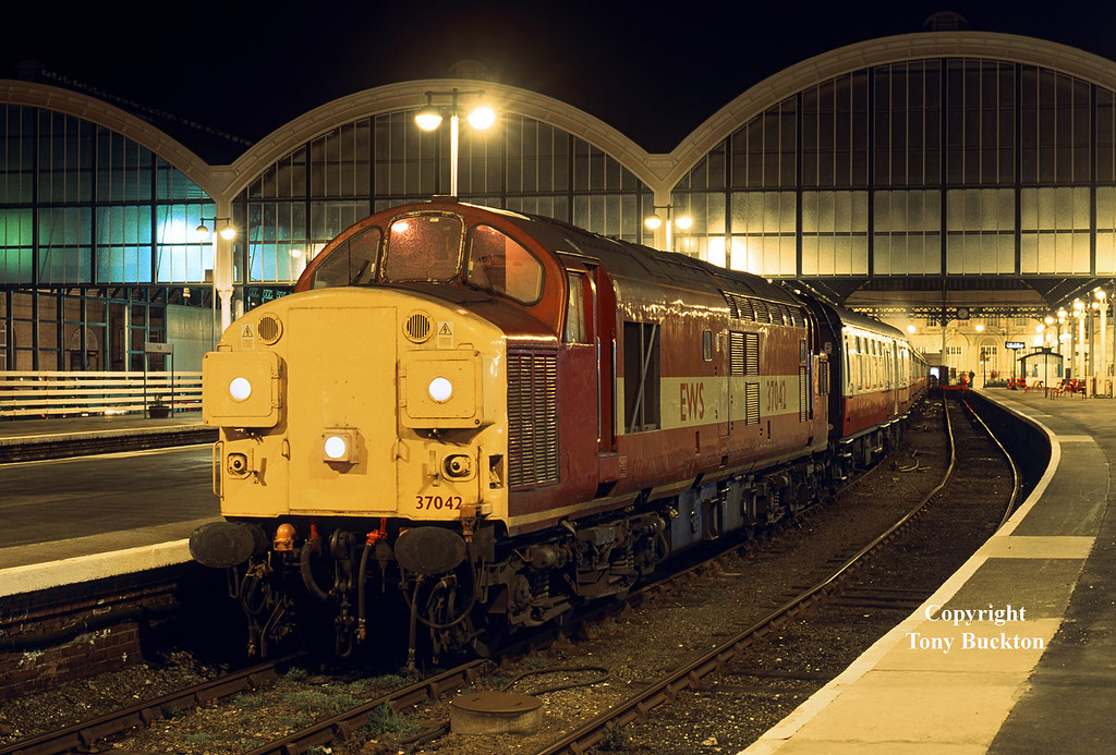 "37042 awaits departure from Hull Paragon at 20:35 on Tuesday 16th February1999 with the 5Z92 Empty Coaching Stock working to Doncaster.<br /> Black 5 45110 was attached at the rear, and had partnered the 37 in a circular dining tour of Yorkshire.<br /> <a href=""https://tonybuckton.smugmug.com/Trains/Steam/i-bNFrsnD"">https://tonybuckton.smugmug.com/Trains/Steam/i-bNFrsnD</a>"