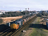 37710 looks resplendent in Load Haul black and orange whilst passing Barnby Dunn near Kirk Sandall at 10:00 on Friday 11th February 2000, with the 6V14 Hull Saltend - Baglan Bay.