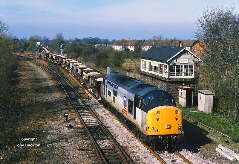 On Sunday 19th March 2000, 37799 sets back through the crossover at Gilberdyke Jnc with a very long rake of Dogfish ballast hoppers, forming the 8T56 Doncaster - Broomfleet engineers trip. After setting back the train worked 'wrong line' to Broomfleet before a reversal.