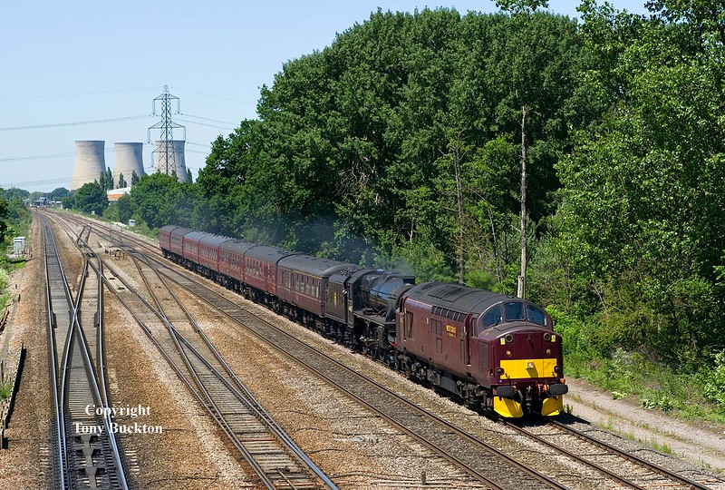 With the cooling towers of Didcot power station as a backdrop, 37706 leads Black 5 44871 through South Moreton with the 6Z84 Carnforth - Southall stock Move on Thursday 17th June 2010.
