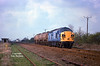 37013 approaches Lowfield Lane, Melton, in a lucky patch of sunlight at 12:40 on Monday 6th April 1998 with the 6E39 08:10 Mostyn Dock - Hull Saltend acetic acid tanks. The signals and gate box in the distance are the installation at Welton crossing near Brough.