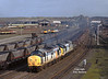 During February 1995 a class 60 shortage led to a number of restricted use class 37's being pressed into action on steel workings from Scunthorpe - the morning of the 15th saw 37333 and 37225 pass Brigg Road with a load of slabs destined for Tinsley.