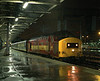 37408 sparkles in the pouring rain while awaiting the road from Crewe platform 12 with the empty stock off 1K77 18:20 from Bangor, at 20:20 on Wednesday 12th January 2000.