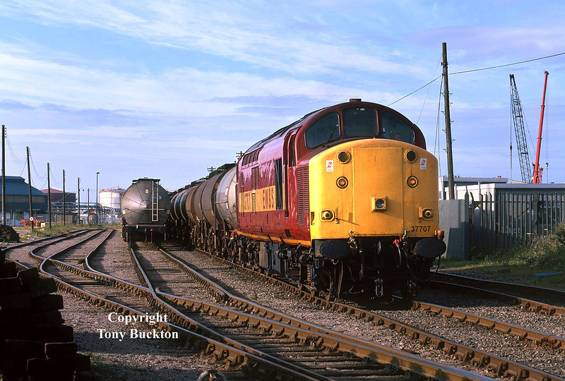 Four days after my last visit, I returned to Saltend Reception Sidings to photograph 37707 awaiting departure with the 6V14 to Baglan Bay on Friday 26th June 1998 - an earlier arrival of the locomotive meant the sun was at a better angle with this photograph being recorded at 06:55.