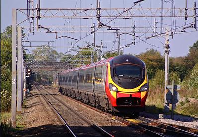 390009 'Treaty of Union' approaches Acton Bridge Station on 28/09/11.