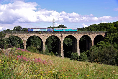 47501 'Craftsman' propels inspection saloon 'Caroline' towards Barnsley, accross Oxspring Viaduct near Penistone, working 2Z01 08:16 York - York.10/08/10.   Once class 76 hauled freights passed here running between Manchester and Sheffield, and you can still see where the overhead masts were once bolted to the side of the Viaduct.