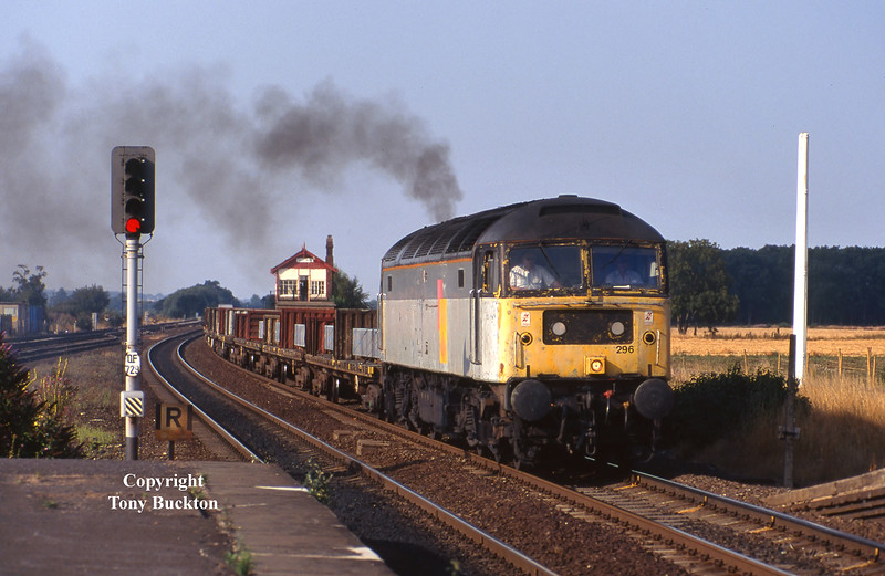 A scruffy 47296 passes Church Fenton at 17:25 on Wednesday 18th August 1995 with the 4V03 14:06 Lynmouth - Pengham aluminium ingots.