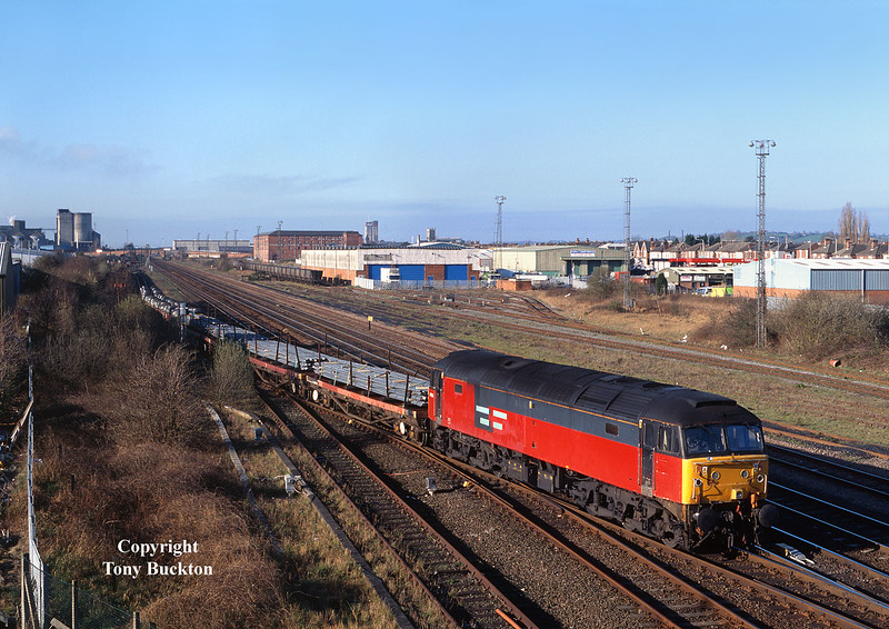 47759 sets down loaded BDA's at Burton on Trent on the morning of Tuesday 26th March 2002. Running as the 6D36 05:49 Enterprise service from Bescot, the loco would then pick up from the wagon repair facility before continuing to Toton later in the morning.