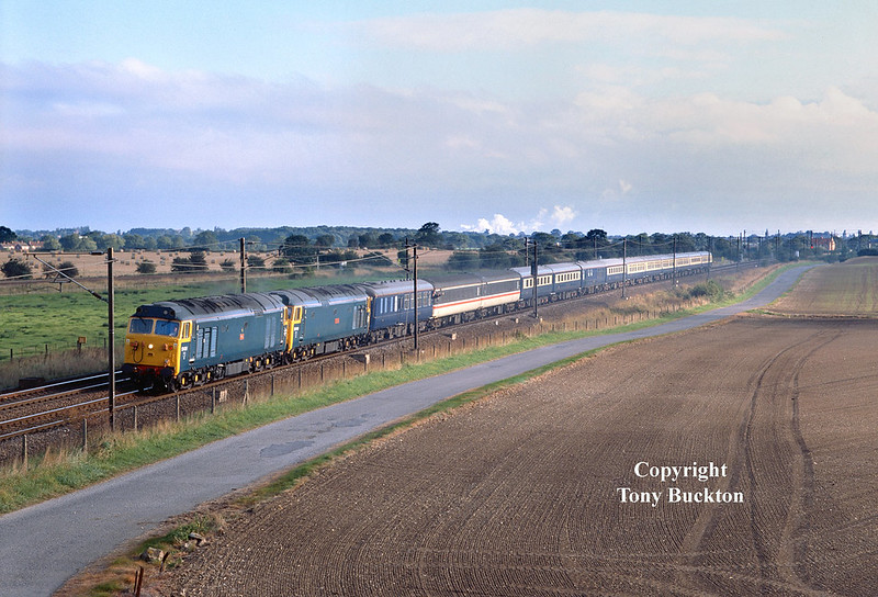 At 08:20 on Sunday 22nd September 2002, 50031 and 50049 head South on the East Coast Main Line from York at Coulton Jnc with a 'Countryside Alliance' charter to Finsbury Park.
