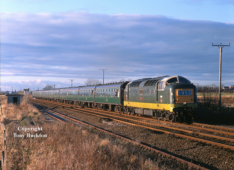 D9009 passes Lowfield Lane, Melton, in dramatic light at 13:35 on Saturday 28th December 2002, with the Deltic Scarborough Flyer.