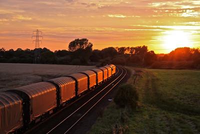 56094 waits at Stenson with 6M08 17:20 Boston Docks - Washwood Heath steel at sunset on 03/09/12.