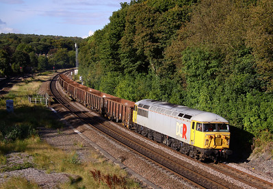 56311 sweeps round the curves past Dore & Totley Station with 6Z57 14:45 Attercliffe - Chaddesden, comprising of Nine JRA's.  19/09/12.