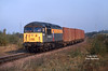56036 approaches the site of the burned out signal box at Dragonby at 10:30 on Saturday 18th October 1997, with the 6D86 Roxby - Grimsby empty Tioxide containers.
