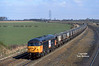 56039, the first of the class to be named 'ABP Port of Hull', passes Burton Salmon at 12:37 on Wednesday 29th March 1995 with a West-bound MGR from Milford Yard.