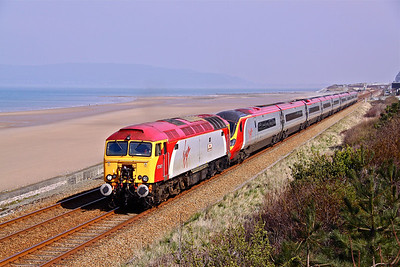 57307 (ex-47225) 'Lady Penelope' drags 1D83 08:50 London Euston - Holyhead service formed of Pendolino 390015 past Penmaenmawr. 26/03/11.