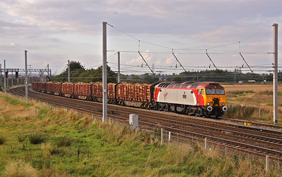 57304 passes Winwick, North of Warrington with 6J37 Carlisle - Chirk loaded timber,