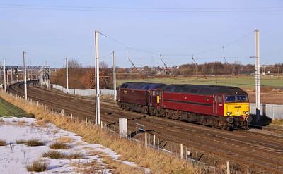 57601 and 47851 run light engines past Winwick, working 0Z23 09:42 Carnforth - Crewe, 17/12/10.  I've included this picture to show the difference in livery between the Two West Coast Loco's