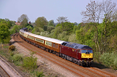 57001, in its new coat of West Coast maroon paint, slows for a signal check at North Staffs Junction while hauling 1Z63 06:08 Blackpool North - Spalding pullman. 30/04/11.