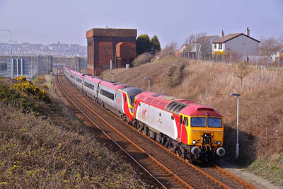 57307 'Lady Penelope' drags Pendolino 390015 away from Holyhead while working 1A55 14:38 to London Euston, as far as Crewe. 26/03/11.