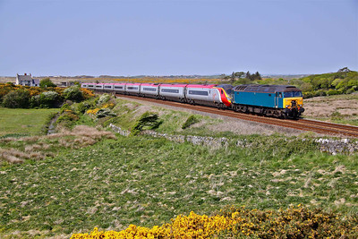 57316 (ex-47290) drags 390044 past Rhosneigr, Angelsey working 1A55 14:36 Holyhead - Euston. 22/05/10.