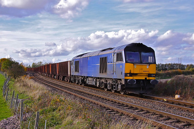60011 snakes round the reverse curves on the approach to Bramwith Crossing with 6D02 Redcar - Santon Iron Ore tipplers, 30/10/10.