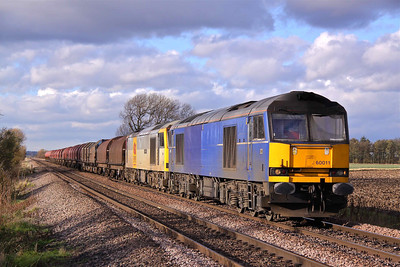 60011, and dead in tow 60091 pass Elsham Carrs, East of Scunthorpe working the late running 6E20 Margam - Immingham. 13/11/10.