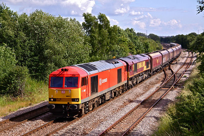 60011 leads 66110 past Treeton South on 6E94 15:30 Ratcliffe Power Station- Milford empty Coal HTA's.
