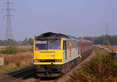 60013 'Robert Boyle' approaches Fidlers Ferry Crossing with 6F74 Liverpool Bulk Terminal - Fidlers Ferry Power Station coal train. 13/10/10.