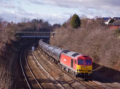 60011 crawls past Horbury with 6E32 08:55 Preston Docks - Lindsey discharged bitumen tanks, 15/02/12.